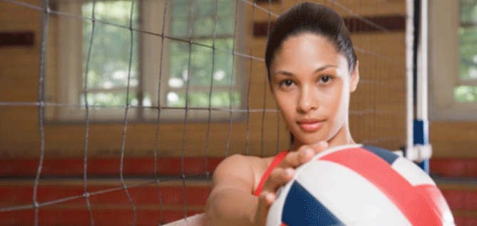 Woman holding a volleyball