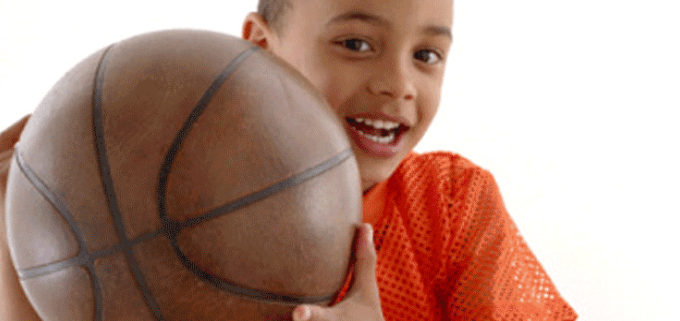 A young boy holding a basketball